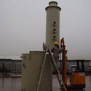 Photo shows assembly on site of fume scrubber tower