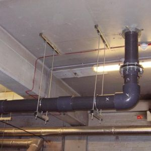 8 inch diameter PVC water supply pipe c/w fire damper installed in roof – Magna Science Museum Rotherham