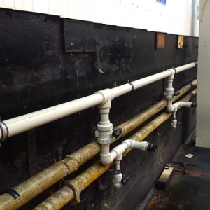 Polypropylene acid feed pipework installed on-site.