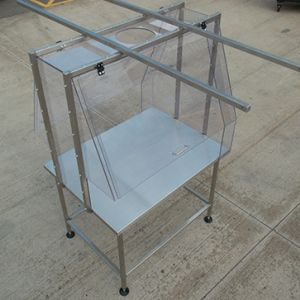 Clear polycarbonate enclosure c/w stainless steel work table.